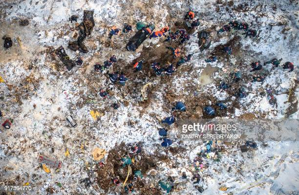 TOPSHOT An aerial picture taken in the Ramensky district on the outskirts of Moscow on February 12 2018 shows emergency rescuers working at the site...