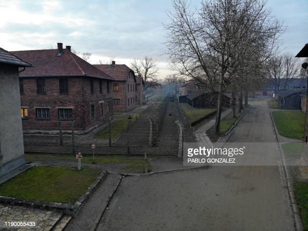 An aerial picture taken on December 15, 2019 in Oswiecim, Poland, shows a view of the blocks of Auschwitz I, which was part of former German Nazi...