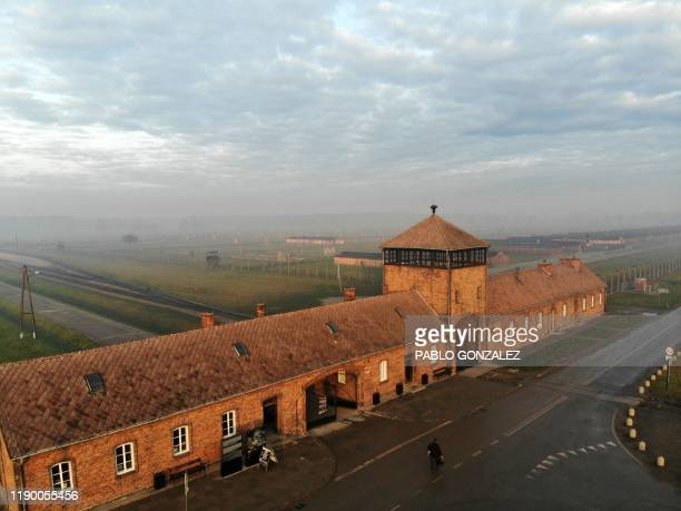 An aerial picture taken on December 15, 2019 in Oswiecim, Poland, shows a view of the railway entrance to former German Nazi death camp Auschwitz II...