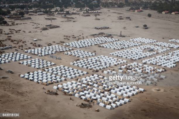 An aerial picture taken on February 14 2017 at Monguno district of Borno State shows a camp for internally displaced people The Nigerian airforce has...