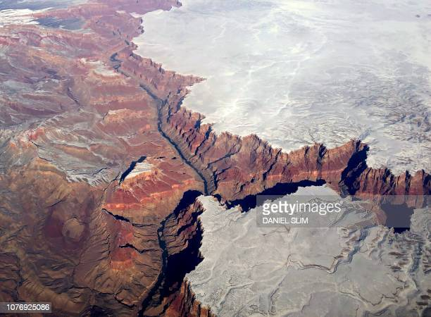 TOPSHOT An aerial picture taken on January 3 shows the Grand Canyon covered with snow in Arizona
