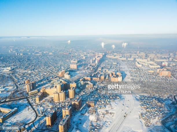 An aerial picture taken on January 4, 2018 shows a photochemical smog over the city of Krasnoyarsk. Weary of local officials dismissing the deadly...