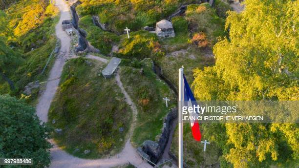 An aerial picture taken on July 11 2018 near Orbey eastern France shows the French national flag flying at the site of the World War One battlefield...