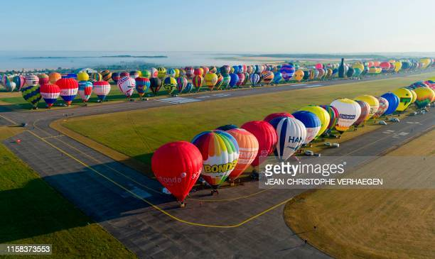 An aerial picture taken on July 29 2019 shows more than 400 hot airballoons at the ChambleyBussieres airbase in Hagéville eastern France before an...