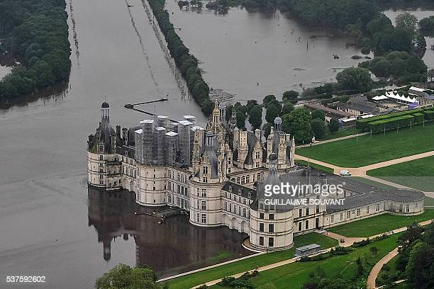An aerial picture taken on June 2 2016 shows the castle of Chambord some 170 kilometers southwest of Paris and its partly flooded park after the...
