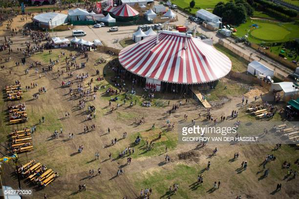 An aerial picture taken on June 24 2016 shows the Cesar Circus stage during the 18th edition of the Solidays music festival in Paris / AFP / GEOFFROY...