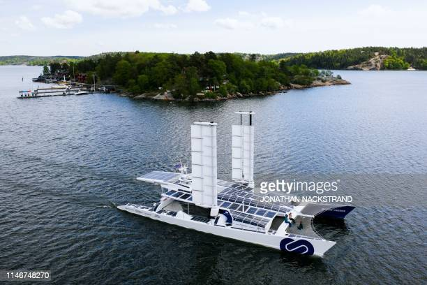 An aerial picture taken on May 28 2019 shows the selfenergy producing multihull Energy Observer sailing off the coast of the Swedish capital...