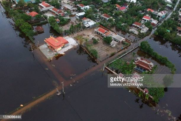 An aerial picture taken on October 15, 2020 shows houses submerged in flood waters caused by heavy rains in Hai Lang district in central Vietnam's...