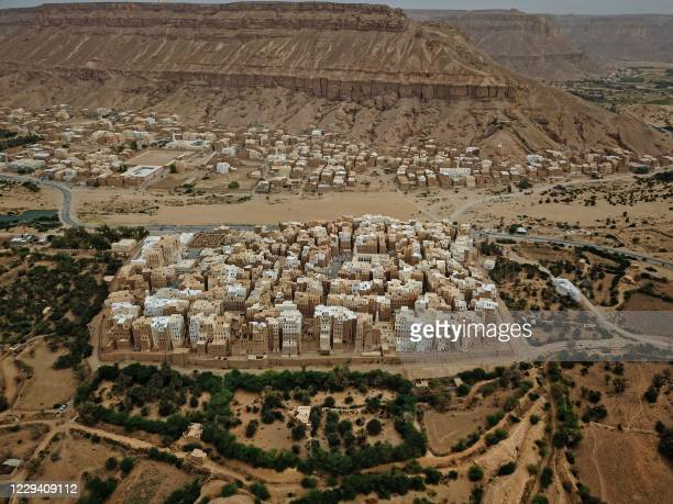 An aerial picture taken on October 17 shows a view of Shibam City in Yemen's central Hadramawt governorate. - Against the backdrop of what resembles...