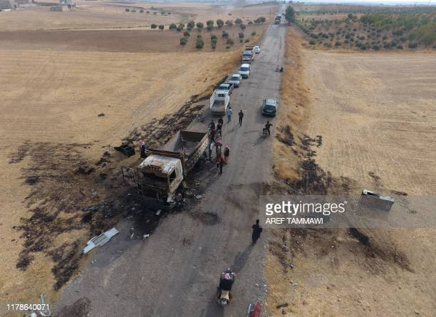 An areal picture taken on October 28 shows vehicles near a destroyed truck at the spot where Abu Hassan alMuhajir the Islamic State group's spokesman...