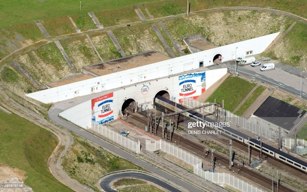 An aerial picture taken on October 8, 2015 shows the Eurotunnel site in Coquelles, northern France, few kilometres from the 'New Jungle' migrants camp where some 3,500 people live. The slum-like migrant camp sprung up after the closure of notorious Red Cross camp Sangatte in 2002, which had become overcrowded and prone to violent riots. However migrants and refugees have kept coming and the 'New Jungle' has swelled along with the numbers of those making often deadly attempts to smuggle themselves across the Channel.