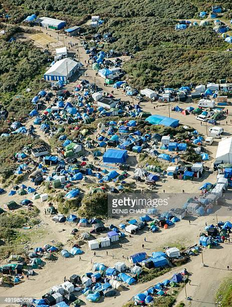 An aerial picture taken on October 8 2015 shows the New Jungle migrants camp where some 3500 people live while they attempt to enter Britain near the...