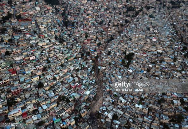 TOPSHOT An aerial picture taken on September 27 2018 shows Jalousie neighborhood in the commune of Petion Ville during the sunset in the Haitian...