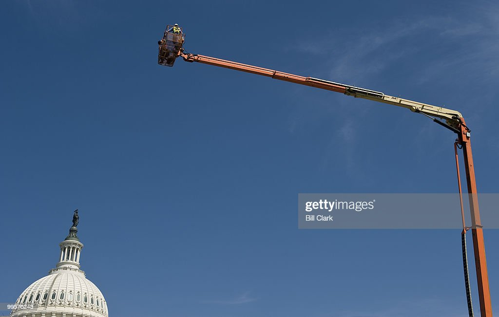 An aerial platform on the south side of the Capitol provides a unique view of the Capitol grounds for a photographer on Monday, April 5, 2010.