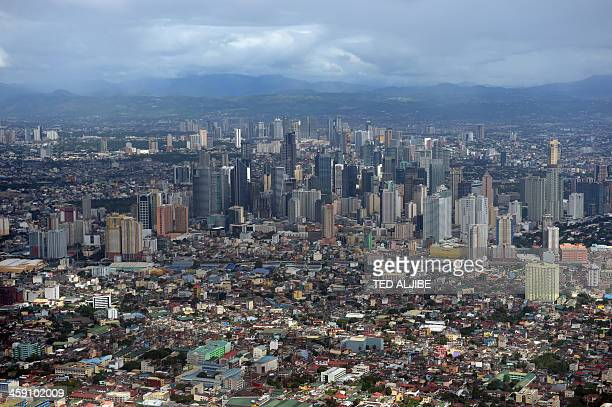 An aerial shot of Manila on December 23, 2013. The Philippine economy should grow 7.0 percent this year, and between 6.5 and 7.5 percent next year,...