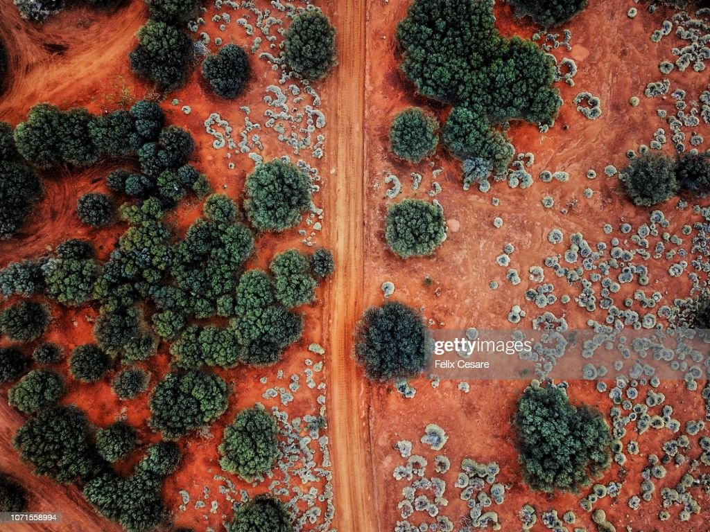 An Aerial shot of the red centre roads in the Australian Outback : Stock Photo
