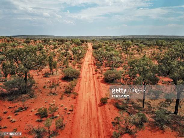 an aerial shot of the red centre roads in the australian outback - naturwunder stock-fotos und bilder