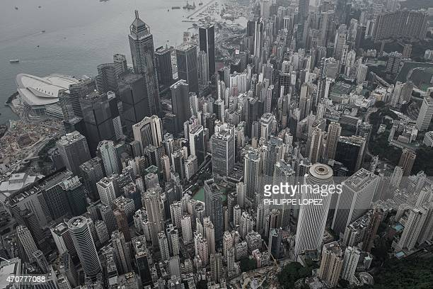 An aerial shot shows buildings on Hong Kong and a section of Victoria harbour on April 23 a day after the city's government unveiled its...
