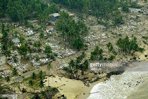 An aerial shot taken from a helicopter shows debris of houses destroyed by tsunamis in the Galle district in the southwestern coast of Sri Lanka 27...