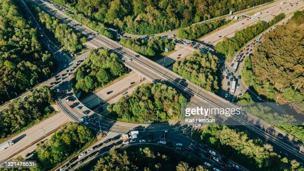 an aerial sunset view of a uk motorway junction - stock photo - day stock pictures, royalty-free photos & images