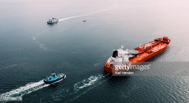 an aerial sunset view of an oil tanker on the solent sea, uk - stock photo - portsmouth england stock pictures, royalty-free photos & images