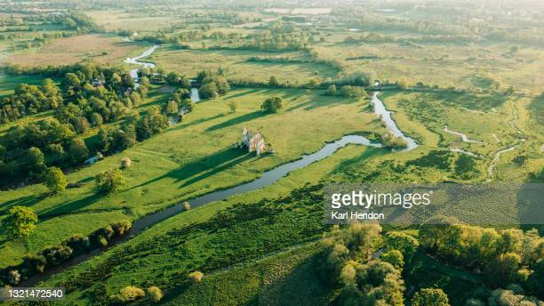an aerial sunset view of the newark priory ruins, surrey - stock photo - national park stock pictures, royalty-free photos & images