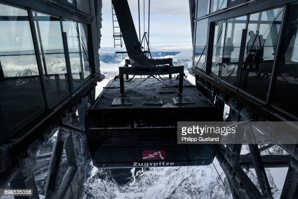 An aerial tramway of the new 'Eibsee Seilbahn' cable car connection arrives at the Zugspitze peak on the system's inauguration day on December 21...