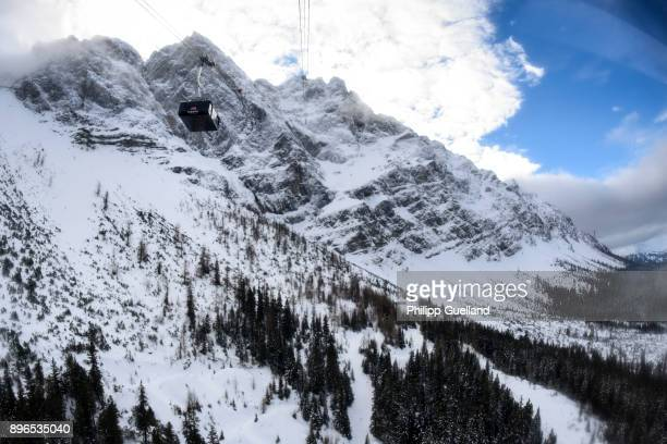 An aerial tramway of the new Eibsee Seilbahn cable car connection returns from the Zugspitze peak on the system's inauguration day on December 21...