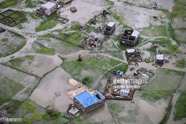 TOPSHOT An aerial view a flooded district on the outskirts of the city of Beira central Mozambique on March 20 after the passage of cyclone Idai...
