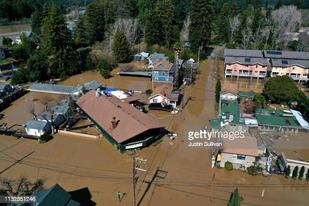 An aerial view a flooded neighborhood on February 28 2019 in Guerneville California The Russian River has crested over flood stage and is now...