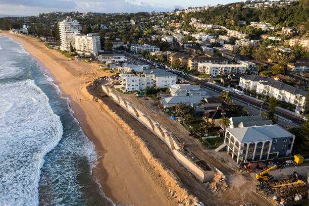 AUS: Concrete Seawall Constructed To Protect Beachfront Homes In Sydney From Coastal Erosion