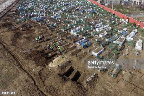 An aerial view as gravediggers work at a cemetery to earn their living in Van, Turkey on April 12, 2017.