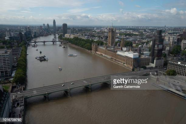 An aerial view as police officers secure Westminster Bridge going towards the Houses of Parliament after a vehicle crashed into security barriers,...