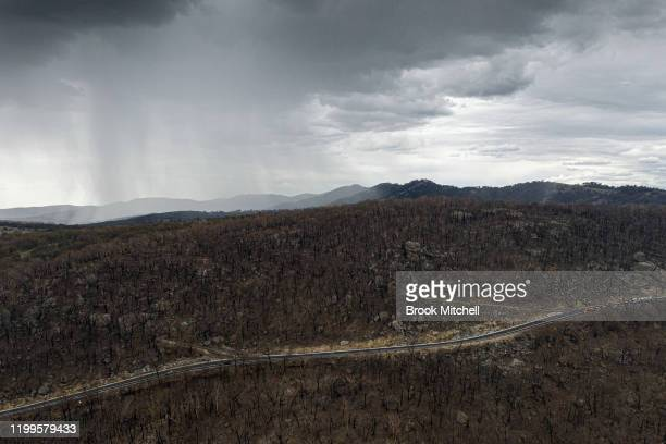 An aerial view as rain begins to fall on drought and fire-ravaged country near Tamworth ahead of predicted further wet weather across NSW and...