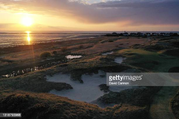 An aerial view as the sun sets over the 11th green which play as the 13th hole in The Open Championship at Royal Liverpool Golf Club on April 30,...
