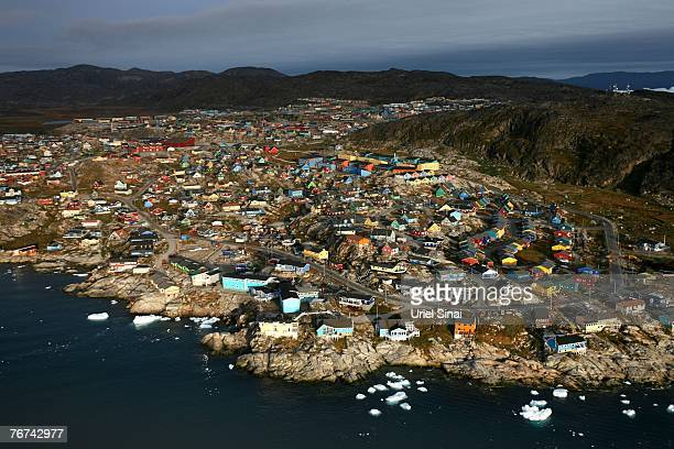 An aerial view August 30 of the town of Ilulissat, Greenland. Even though the disappearing ice cap could lead to higher sea levels all over the...