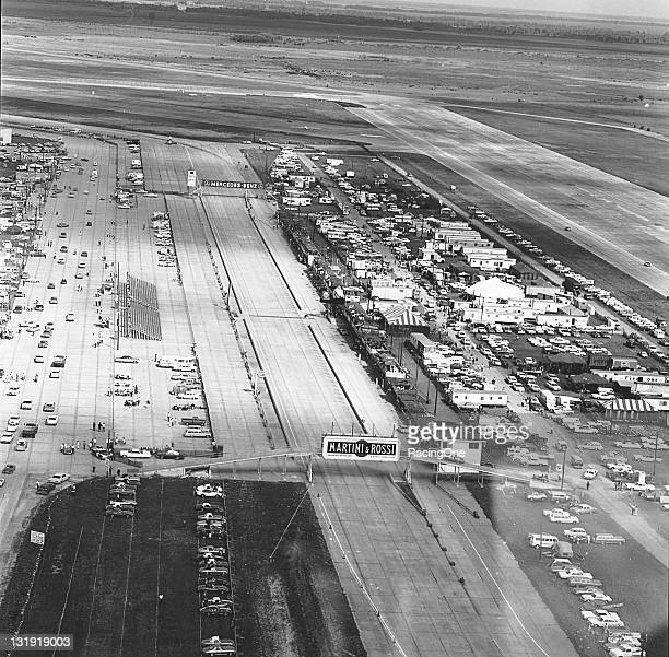 An aerial view down the main straight of Sebring International Raceway shows also the pit area on the right and the spectator grandstands on the...