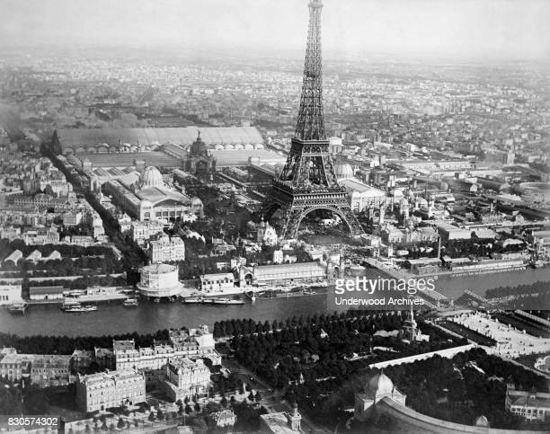 An aerial view from a balloon showing the Seine River and the Eiffel Tower at center and buildings of the Exposition Universelle Paris France 1889