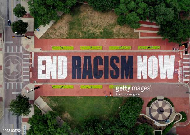 An aerial view from a drone as residents view the End Racism Now mural painted on Main Street in downtown on June 28 2020 in Fort Worth Texas Local...