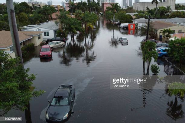 An aerial view from a drone shows a street inundated with flood water on December 23, 2019 in Hallandale, Florida. The area received up to 12 inches...