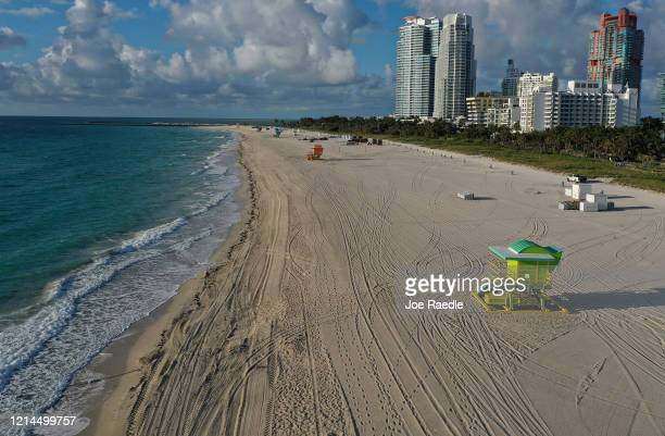 An aerial view from a drone shows an empty closed beach as the city continues its efforts to prevent the spread of the coronavirus on March 24 2020...