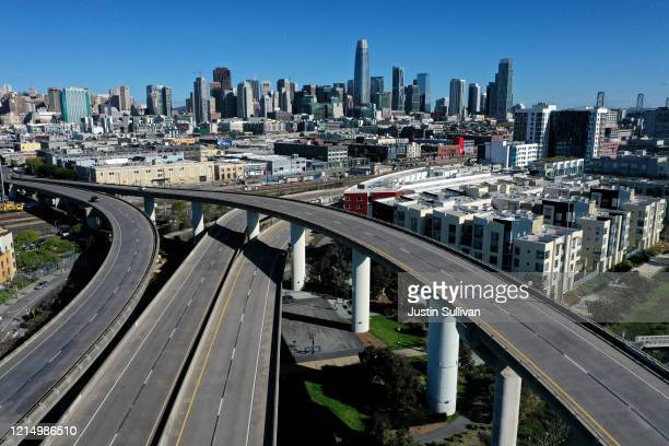 An aerial view from a drone shows an empty Interstate 280 on March 26, 2020 leading into San Francisco, California. With millions of San Francisco...