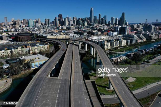 An aerial view from a drone shows an empty Interstate 280 on March 26 2020 leading into San Francisco California With millions of San Francisco Bay...