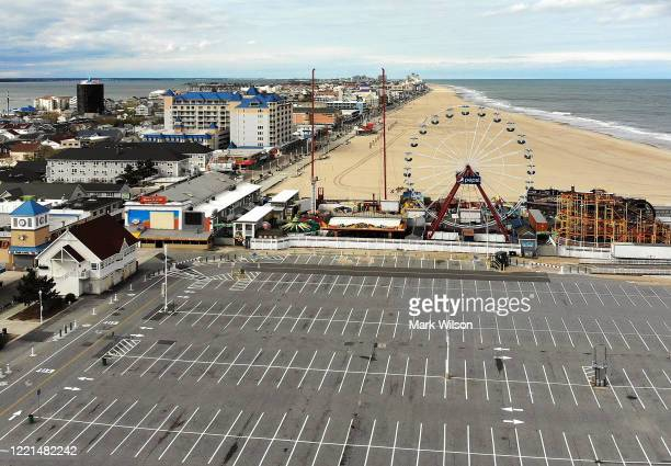 An aerial view from a drone shows an empty parking lot and beach on April 27 2020 in Ocean City Maryland The beach and boardwalk were closed after...