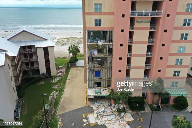An aerial view from a drone shows an outer wall of the Tropic Isles complex torn off after Hurricane Sally passed through the area on September 17...