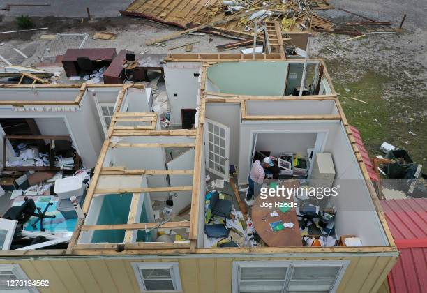An aerial view from a drone shows Dr Joseph Mirabile as he salvages what he can after the roof was blown off his real estate business when Hurricane...