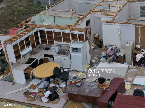 An aerial view from a drone shows Dr Joseph Mirabile as he salvages what he can after the roof was blown off of his real estate business when...