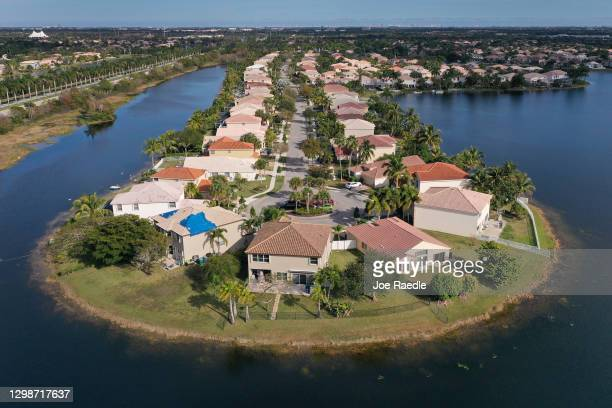 An aerial view from a drone shows homes in a neighborhood on January 26, 2021 in Miramar, Florida. According to two separate indices existing home...