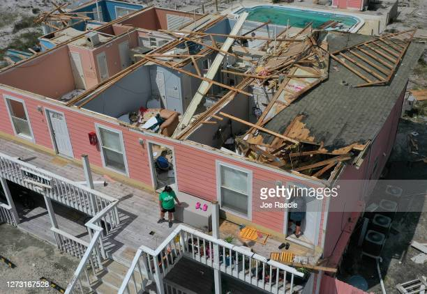 An aerial view from a drone shows Jamie Cade waiting as her mother Jody Wright walks into her damaged apartment after the roof was damaged when...