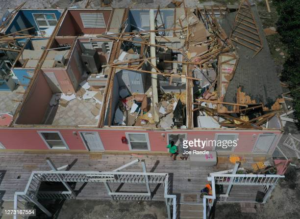 An aerial view from a drone shows Jody Wright and her daughter Jamie Cade looking into her neighbors apartment after the roof was blown off when...
